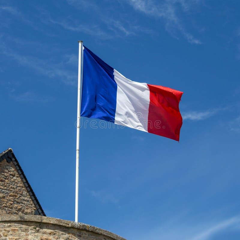 Drapeau français ondulant dans le vent photographie stock