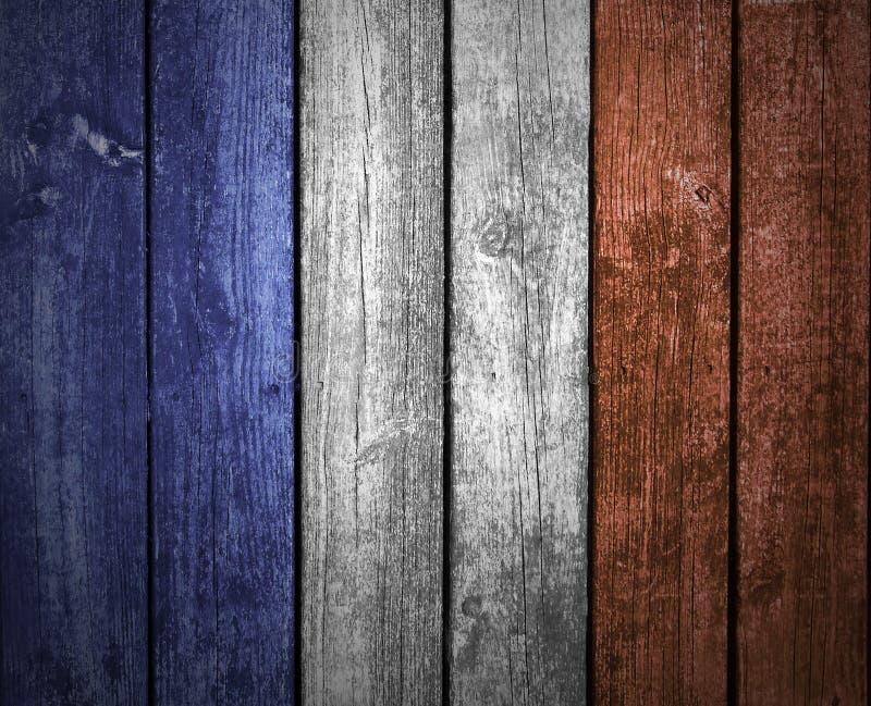 Drapeau français sur le fond en bois images stock