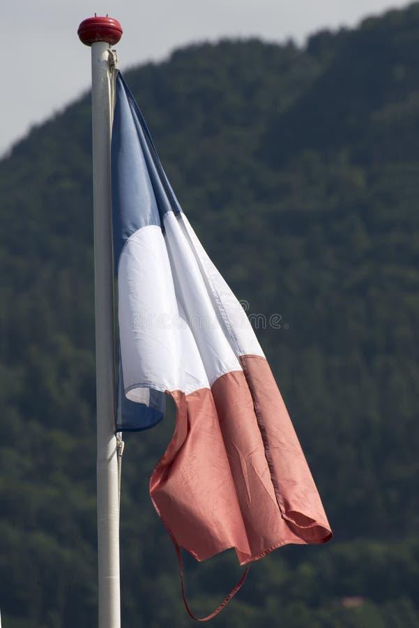 Drapeau français sur un bateau suisse image stock