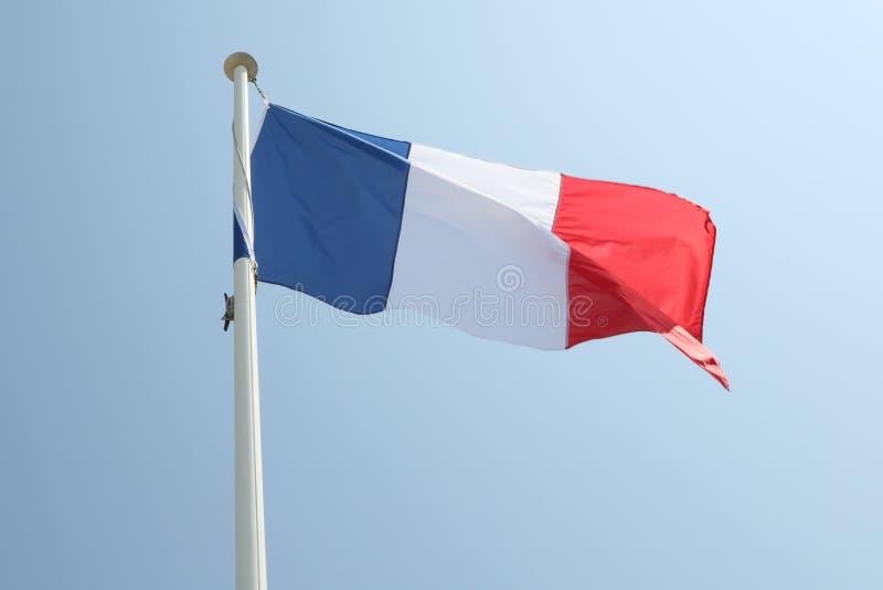 Drapeau français sur un tapis dans le vent photos libres de droits