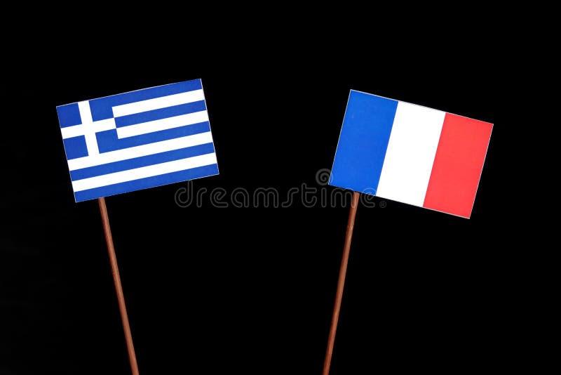 Drapeau grec avec le drapeau français d'isolement sur le noir photo libre de droits
