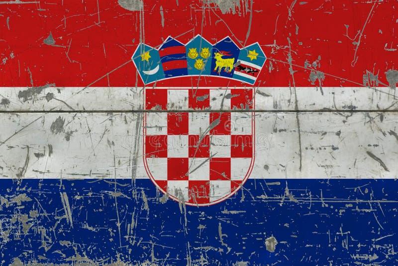 Drapeau grunge de la Croatie sur la vieille surface en bois rayée Fond national de cru photographie stock