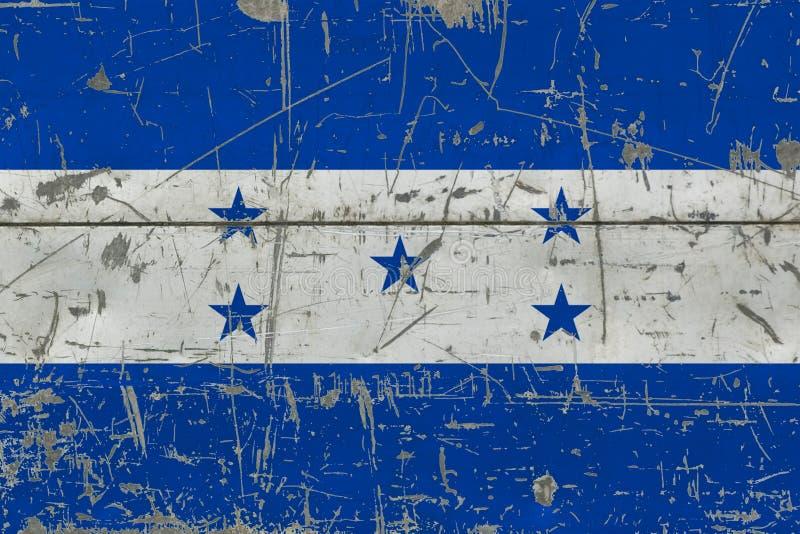 Drapeau grunge du Honduras sur la vieille surface en bois rayée Fond national de cru illustration libre de droits