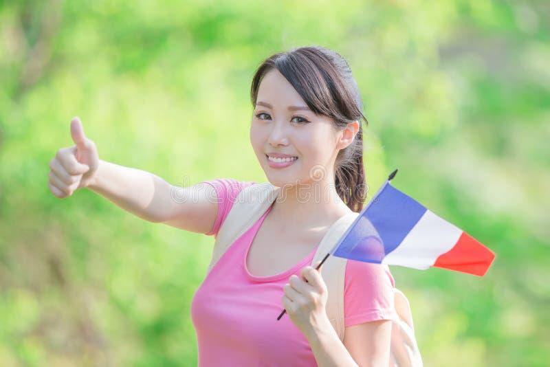 Drapeau heureux de Français de prise de fille images stock