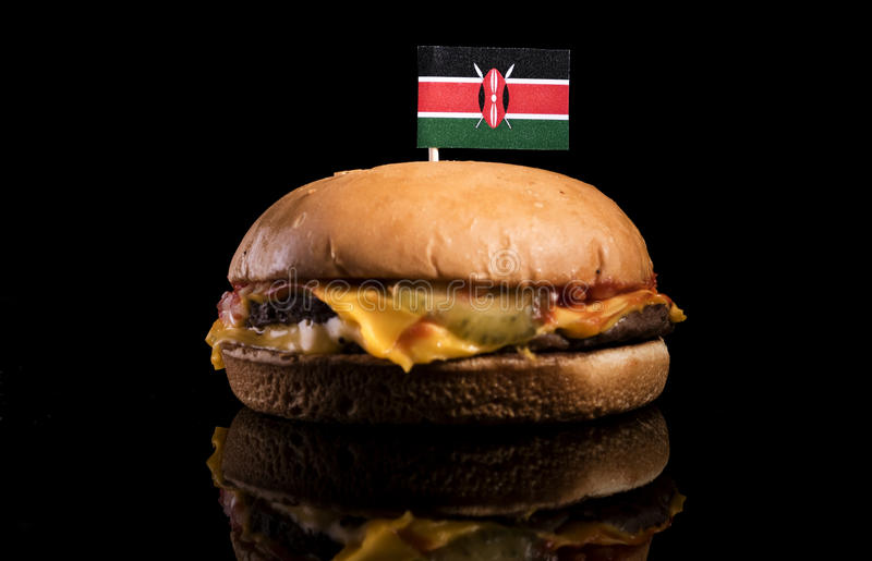 Drapeau kenyan sur l'hamburger d'isolement sur le noir image libre de droits