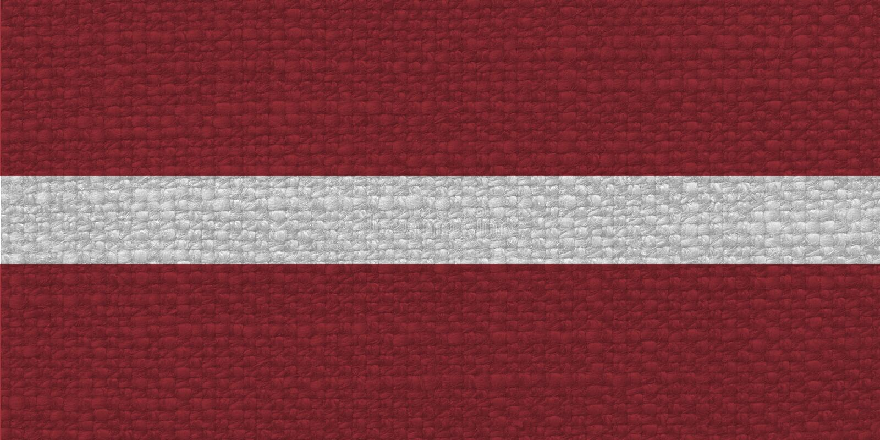Drapeau letton de la Lettonie avec la texture de tissu photo libre de droits