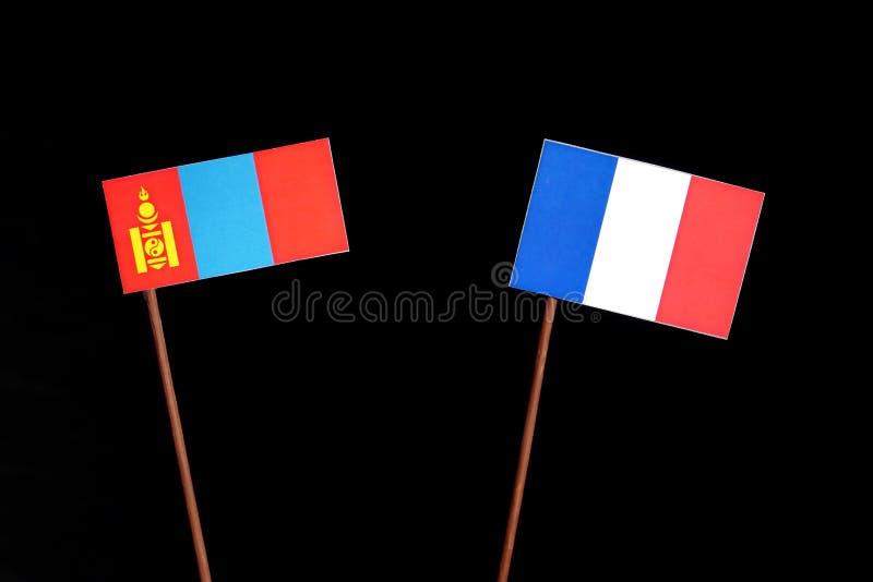 Drapeau mongol avec le drapeau français d'isolement sur le noir photos stock