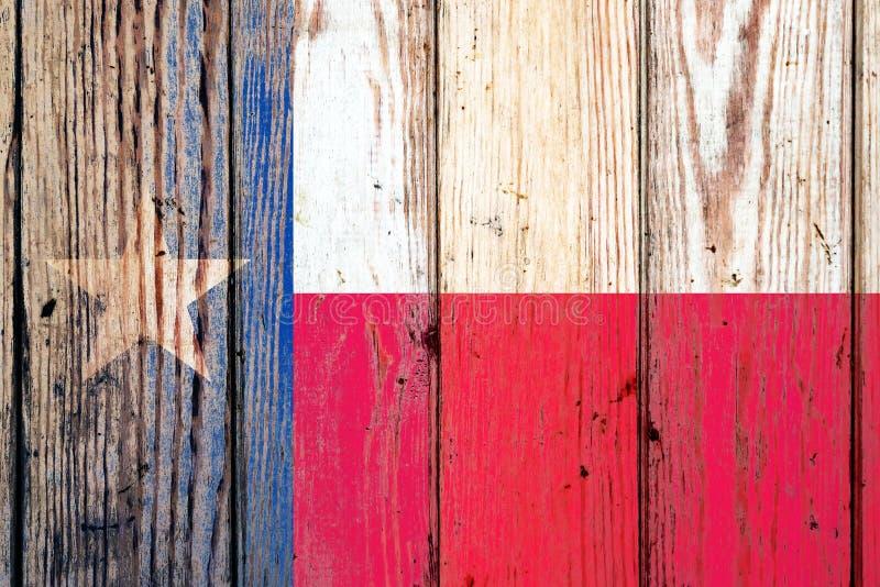Drapeau national d'état du Texas USA sur un fond gris de conseils en bois le jour de l'indépendance dans différentes couleurs de  images stock