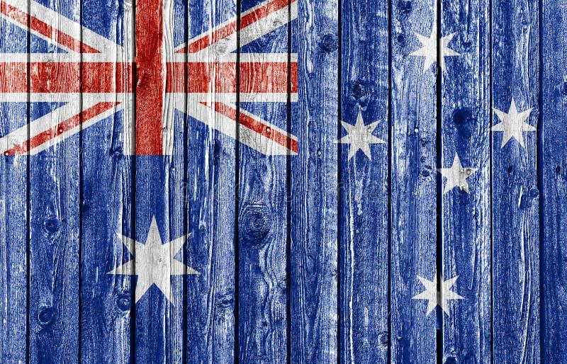 Drapeau national d'Australie sur le vieux fond en bois photos stock