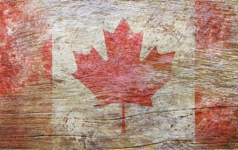 Drapeau national du Canada sur le fond en bois texturisé photo stock