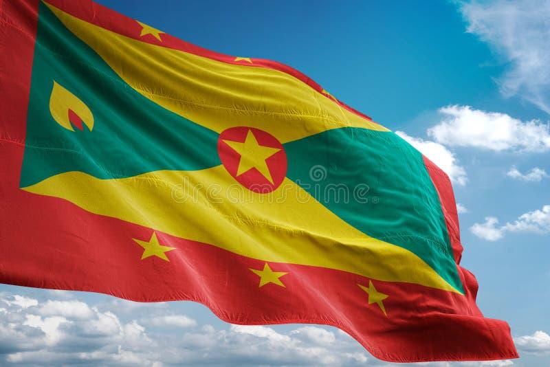 Drapeau national du Grenada ondulant l'illustration 3d réaliste de fond de ciel bleu illustration libre de droits