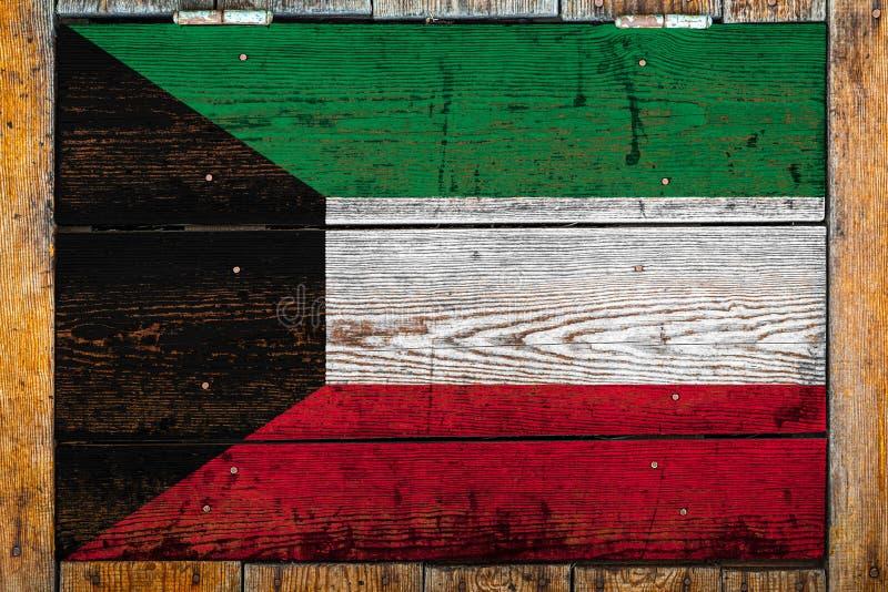 Drapeau national sur un fond en bois de mur image stock