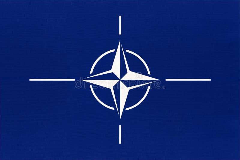 Drapeau officiel de l'Organisation du Traité de l'Atlantique Nord Symbole de l'OTAN et symbole de l'Alliance internationale image libre de droits