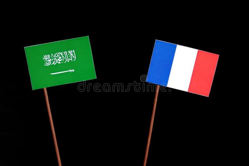 Drapeau saoudien avec le drapeau français sur le noir photographie stock