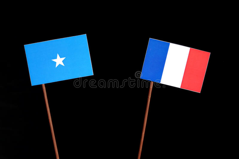 Drapeau somalien avec le drapeau français sur le noir photos libres de droits
