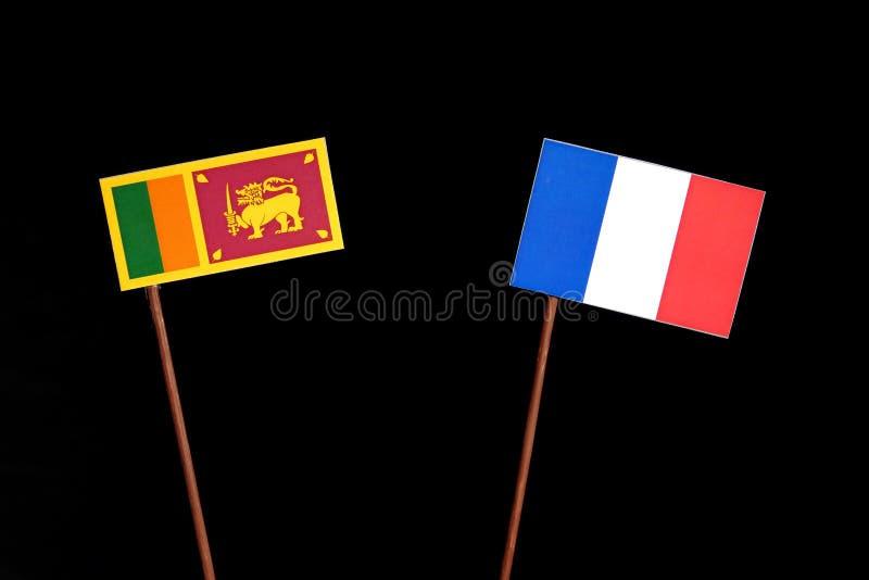 Drapeau sri-lankais avec le drapeau français sur le noir photo libre de droits