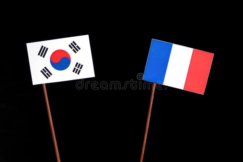 Drapeau sud-coréen avec le drapeau français d'isolement sur le noir photos stock