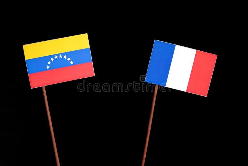 Drapeau vénézuélien avec le drapeau français sur le noir images libres de droits