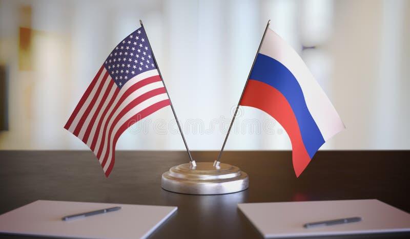 Drapeaux américains et russes sur la table Négociation entre la Russie et les Etats-Unis Illustration de rendu 3D image libre de droits