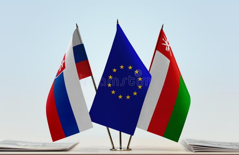 Drapeaux d'UE de la Slovaquie et de l'Oman photo libre de droits