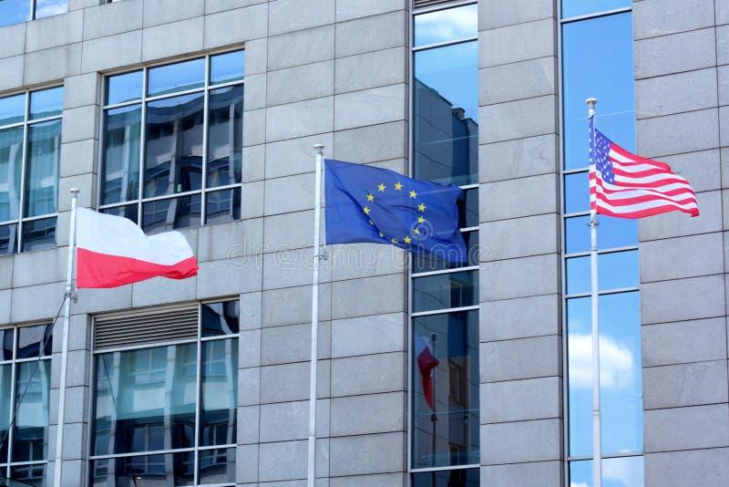 Drapeaux de la Pologne, de l'UE et des USA photos stock