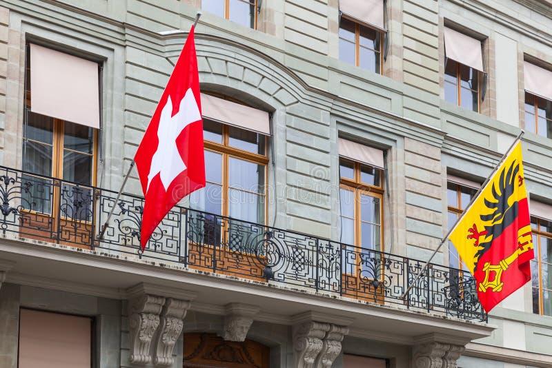 Drapeaux de ville nationale de Suisse et de Genève photo libre de droits
