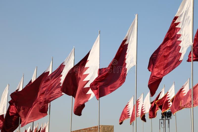Drapeaux du Qatar photographie stock libre de droits