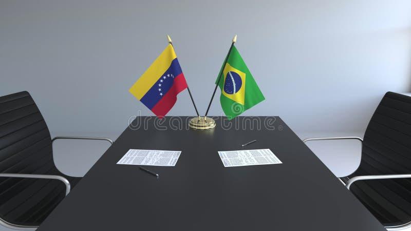 Drapeaux du Venezuela et du Brésil et papiers sur la table Négociations et signature d'un accord international Conceptuel illustration libre de droits