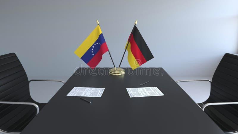 Drapeaux du Venezuela et de l'Allemagne et papiers sur la table Négociations et signature d'un accord international Conceptuel illustration stock