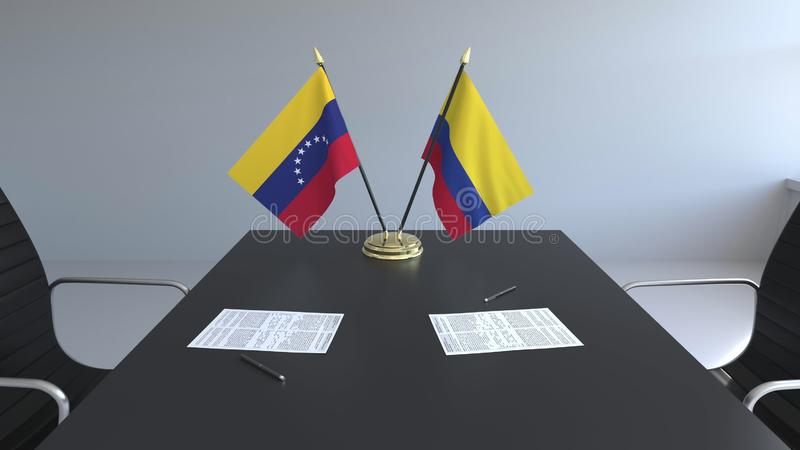 Drapeaux du Venezuela et de la Colombie et papiers sur la table Négociations et signature d'un accord international Conceptuel illustration stock
