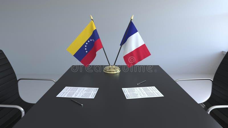 Drapeaux du Venezuela et de la France et papiers sur la table Négociations et signature d'un accord international Conceptuel illustration stock