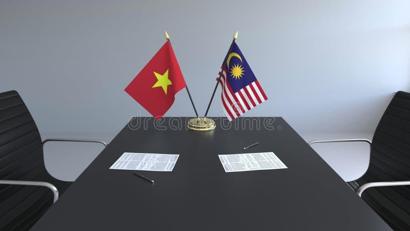 Drapeaux du Vietnam et de la Malaisie et papiers sur la table Négociations et signature d'un accord international Conceptuel illustration libre de droits
