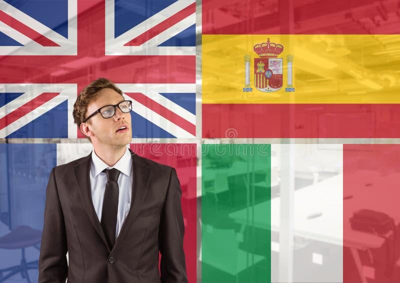 drapeaux principaux de langue autour de la jeune pensée d'homme d'affaires Fond de bureau image libre de droits