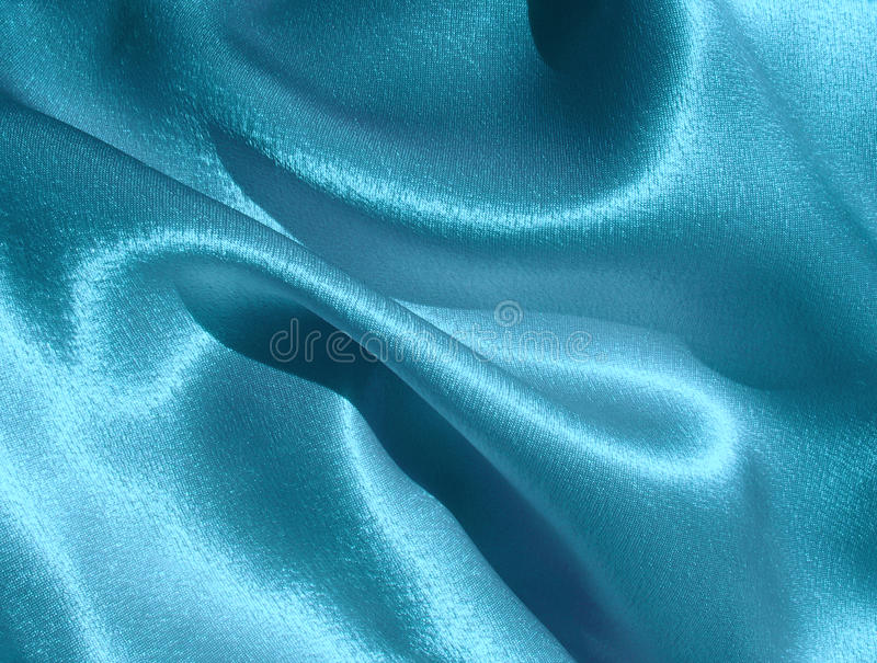 Draped blue satin background royalty free stock photography