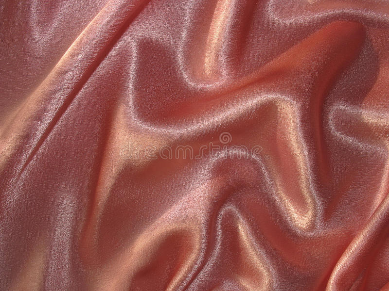 Draped peachy satin background stock images