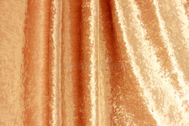 Drapez doucement du tissu d'or photos stock
