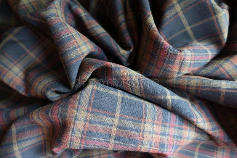 Drapująca gęsta szkockiej kraty tkanina w półgłośnych kolorach obrazy royalty free