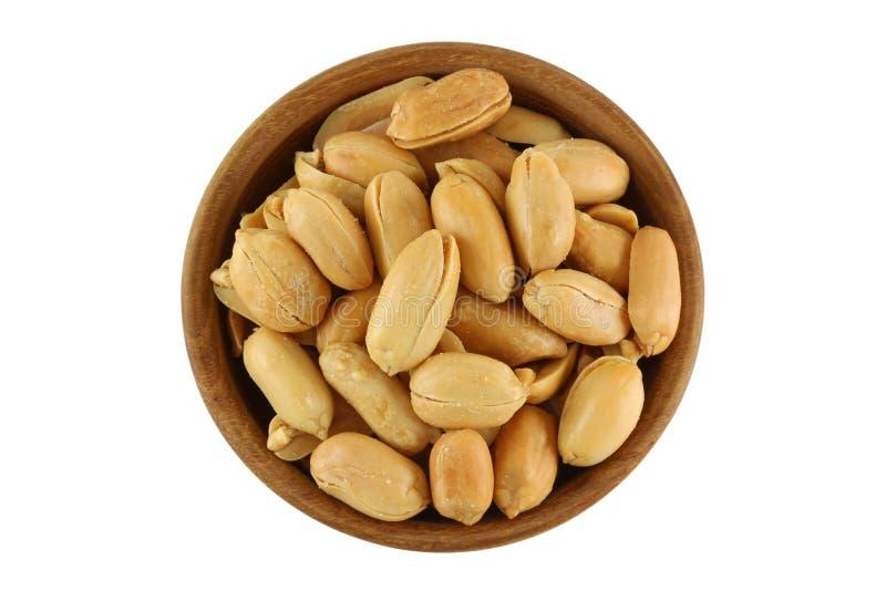 Draufsicht der gebratenen gesalzenen Erdnuss, Erdnuss mit Salz in hölzernem stockfoto