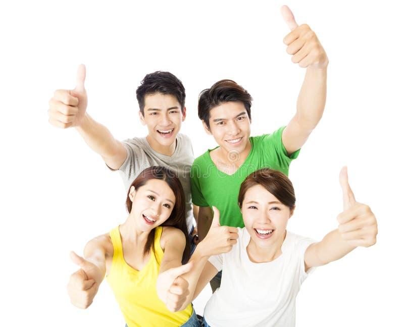 Draufsicht der glücklichen jungen Gruppe mit den Daumen oben stockbilder