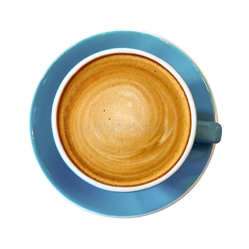 Draufsicht der heißen Kaffeecappuccino Latteschale auf blauem keramischem sauc stockfotografie