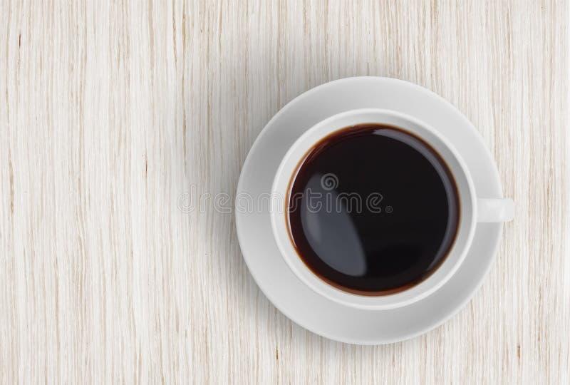 Draufsicht der Kaffeetasse über Holztisch stockbilder