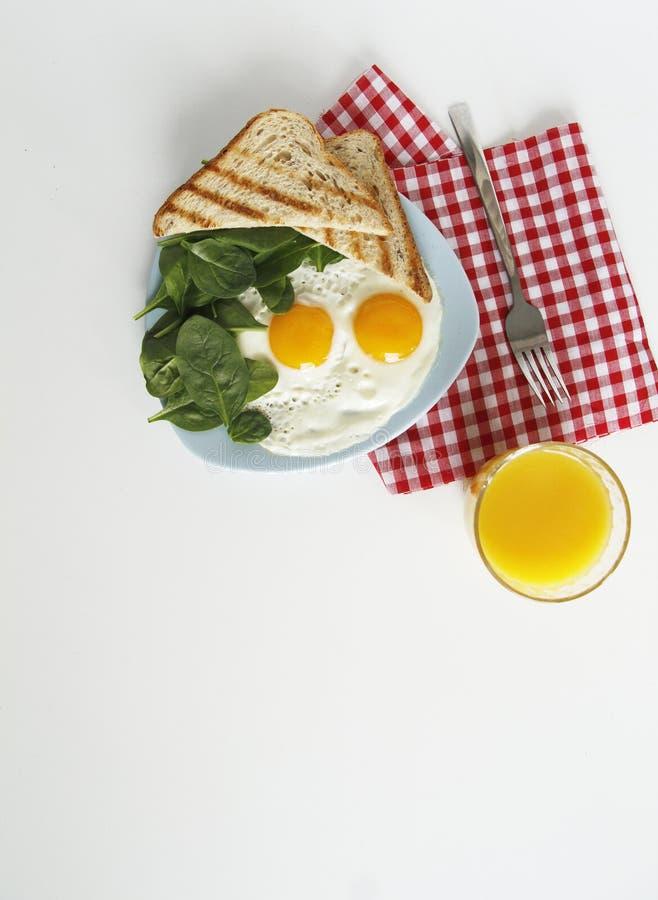 Draufsicht des Fr?hst?cks Eier, Orangensaft lizenzfreies stockfoto