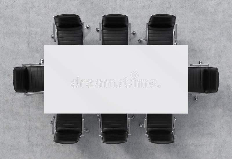 Schwarze Lederstühle draufsicht eines konferenzsaales eine weiße rechteckige tabelle und