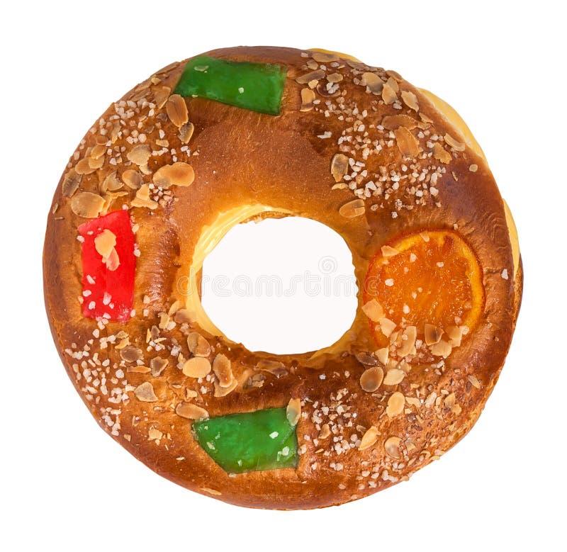 Draufsicht von Königen backen Roscon de Reyes zusammen, die auf Weiß lokalisiert wird lizenzfreies stockfoto