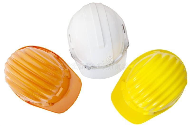Draufsicht von Mehrfarben-safetyt, Bau, Schutzsturzhelm lizenzfreies stockfoto