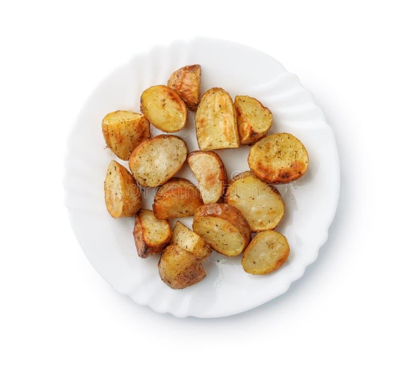 Draufsicht von Ofenkartoffelkeilen auf Platte stockfotos