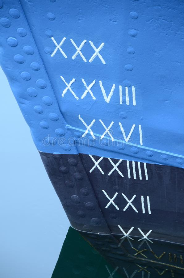 Draught scale with roman numerals on the bow of a ship. royalty free stock images