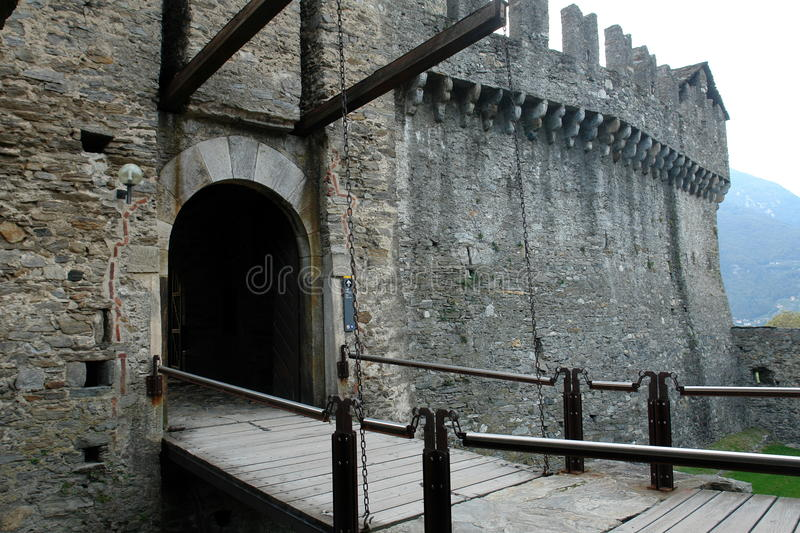 Draw Bridge. A draw bridge leads to a gate in the wall of a medieval fortress in Bellinzona, Switzerland royalty free stock images