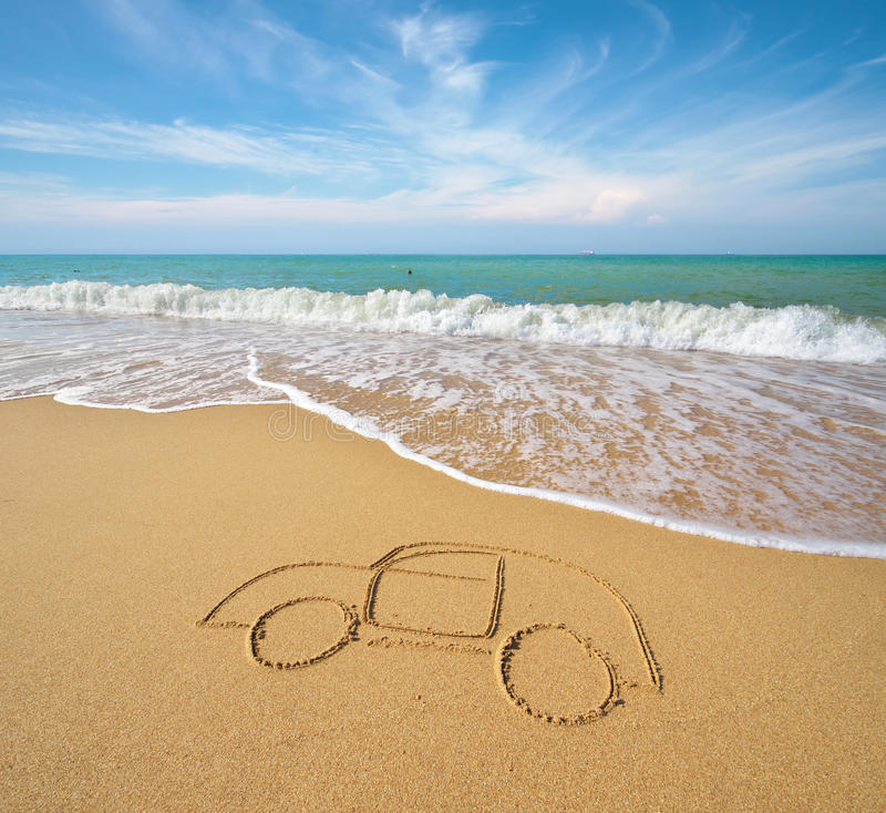 Draw car on beach sand. Conceptual design royalty free stock photography