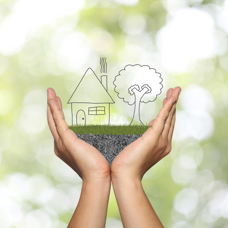 draw shape of house on man hand in concept of residential and ho stock photography